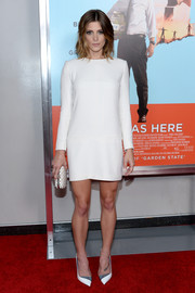 Ashley Greene complemented her outfit with a studded white clutch by Alexander McQueen.