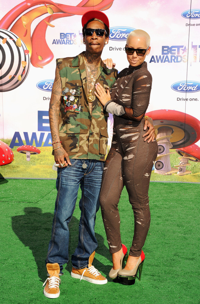 Wiz Khalifa Wore A Camo Vest Covered In Pins For The Bet Awards Alongside Arm Candy