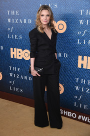 Michelle Pfeiffer styled her suit with a black Judith Leiber envelope clutch with gold trim.
