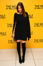 Lisa Snowdon finished off her look in bold style with a pair of black thigh-high boots.