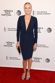 Malin Akerman took a sexy plunge in this form-fitting navy dress for her 'Wolves' premiere look.