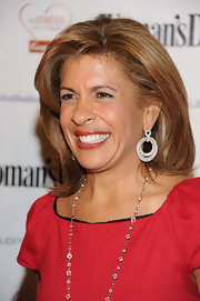 Hoda accented her honey-blond locks with diamond drop hoop earrings.