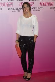Leire Martinez rocked a pair of embellished pants and matched it with a chic cheer top.