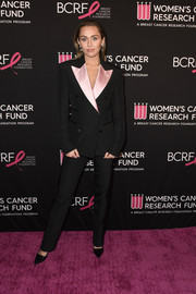 Miley Cyrus was sleek and stylish in a black Tom Ford suit with pink lapels at the Unforgettable Evening gala.