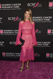 Lori Loughlin completed her black accessories with an envelope clutch.