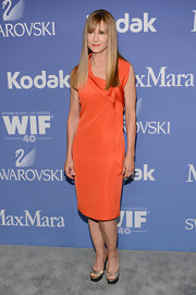 Holly Hunter sported a tangerine-colored classic frock with a side ruffle at the Lucy + Crystal Awards.