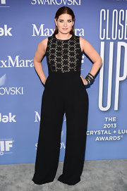 Debra Messing wore this black wide-leg jumpsuit that featured a star-print bodice.