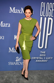 Rose McGowan chose a retro chic sheath dress in a rich green hue for the Crystal + Lucy Awards.