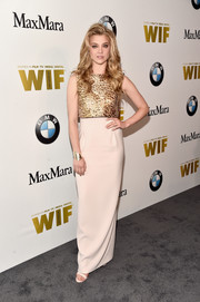 Natalie Dormer went for simple elegance with this Max Mara column dress, featuring a gold bodice and a cream-colored skirt, at the 2016 Crystal + Lucy Awards.