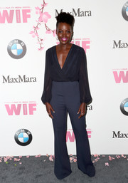Lupita Nyong'o was low-key yet stylish in a midnight-blue wrap top by Max Mara at the 2017 Crystal + Lucy Awards.