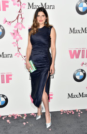 Lake Bell styled her look with a green, blue, and white box clutch by Edie Parker.