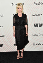 Alice Eve sealed off her all-black look with a pair of ankle-strap sandals.