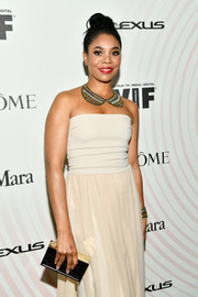Regina Hall paired a gold box clutch with a strapless nude gown for the 2018 Crystal + Lucy Awards.