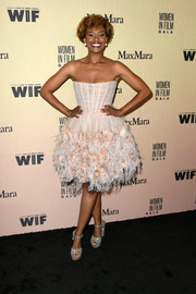 Ryan Michelle Bathe finished off her look with a pair of glittering platform sandals.