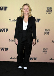 Amy Poehler attended the 2019 Women in Film Gala wearing a black twist-front pantsuit.