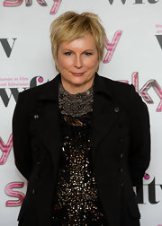 Jennifer Saunders went all out with her accessories, wearing a bib necklace that looked like layers of tiny shells, with trailing feathers for added drama.