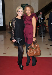 Zoe Lucker paired her of the moment black lace dress with an oversize black leather clutch.