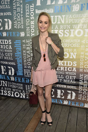 Taryn Manning toughened up her delicate pink dress with a motorcycle jacket when she attended Women's Health's Party Under the Stars.