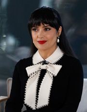 Salma Hayek sported a half-up style with choppy bangs at the Women in Motion event.