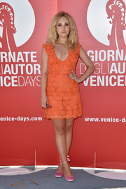 Juno Temple was cute and youthful in a heart-patterned orange mini at the Venice Film Fest photocall for 'Women's Tales.'