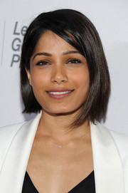 Freida Pinto attended the Women in World Summit wearing a modern, asymmetrical bob.