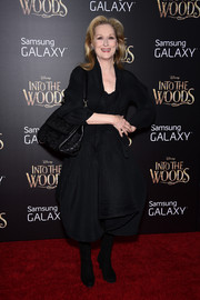 Meryl Streep looked very fashion-forward in an architectural black skirt suit by Issey Miyake at the premiere of 'Into the Woods.'