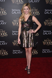 Taylor Louderman teamed her flashy dress with black strappy sandals.