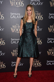 Kim Raver was all about refined elegance in her green and black print dress during the 'Into the Woods' premiere.