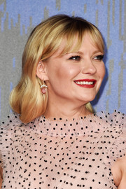 Kirsten Dunst matched her pink frock with a pair of dangling gemstone earrings by Irene Neuwirth.