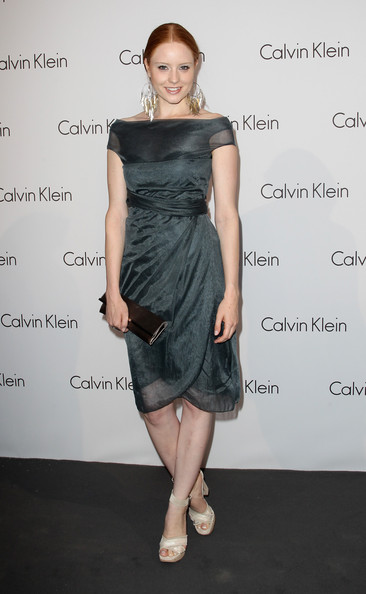 Barbara paired her cream sandals with a forest green off-the-shoulder dress.