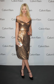 Lara Stone paired her sparkling off-the-shoulder dress with cool ankle strap pumps.