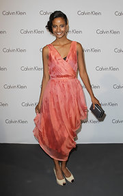 Sara Nuru paired her nude peep toe pumps with a sheer coral dress.