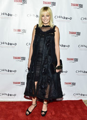 Malin Akerman chose a little black dress with a loose, embellished overlay for her Thank You Gala red carpet look.