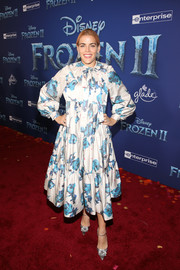 Busy Philipps styled her frock with a pair of bejeweled silver pumps.