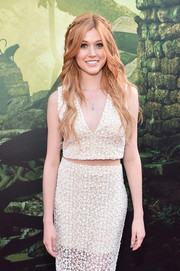 Katherine McNamara charmed in a white lace crop-top and a matching skirt at the world premiere of 'The Jungle Book.'