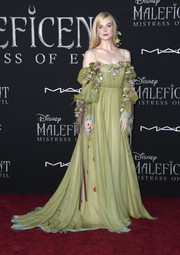 Elle Fanning looked enchanting in a flower-appliqued, cold-shoulder gown by Gucci at the world premiere of 'Maleficent: Mistress of Evil.'