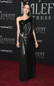 Angelina Jolie was goth-glam in a draped black one-shoulder gown by Atelier Versace at the world premiere of 'Maleficent: Mistress of Evil.'