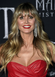 Heidi Klum looked like a doll with her long blonde waves at the world premiere of 'Maleficent: Mistress of Evil.'