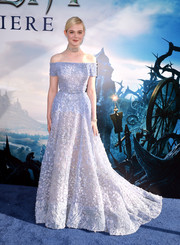 As the princess of the movie, Elle Fanning couldn't have chosen a more appropriate (and dreamier) gown than this ash-blue Elie Saab off-the-shoulder number for the premiere of 'Maleficent.'