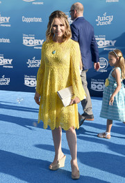 Beverley Mitchell was a cutie at the 'Finding Dory' world premiere in a yellow crochet shift dress by Trina Turk.