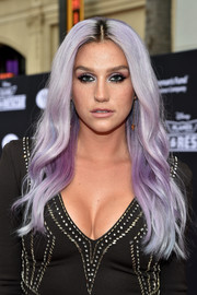 Kesha turned heads with her center-parted purple waves at the premiere of 'Planes: Fire & Rescue.'