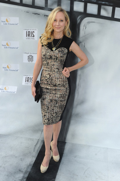 Anne Heche channeled ladylike elegance at the 'Iris' premiere in Hollywood in a demure print dress. She paired the look with cream platform pumps.