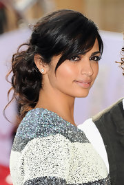 Camila Alves' updo is a fabulous style that's fairly easy to duplicate. To begin, if you've got bangs, section them out and if not, you can incorporate them. Next, pull hair back loosely, maybe take out a few face-framing strands, and then secure tresses into a ponytail. Now comes the fun part! Begin by twisting, wrapping a looping two-inch pieces from the ponytail and pinning them wherever you feel like. There's no right or wrong placement. The effect is so casual, yet you can wear it almost anywhere.
