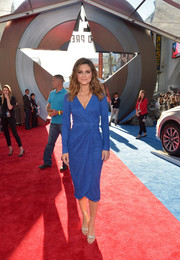 Maria Menounos attended the 'Captain America: Civil War' world premiere wearing a blue wrap dress that showed off her shapely figure.