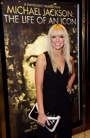 Liz Mcclarnon matched a two-tone envelope clutch with her jumpsuit at the premiere of 'Michael Jackson: The Life of an Icon.'