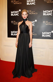 Amber Heard looked deadly in this leather-adorned black gown at the Montblanc store opening in Beijing.
