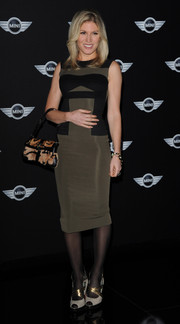Hofit Golan played up her slim figure in a taupe and black sheath during the new Mini world premiere.