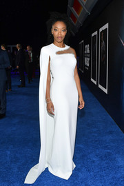 Naomi Ackie looked modern and chic in a white Stella McCartney gown with a yoke cutout and an asymmetrical cape at the world premiere of 'Star Wars: The Rise of Skywalker.'
