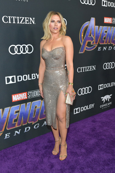 Scarlett Johansson complemented her dress with a pair of metallic slim-strap sandals by Jimmy Choo.