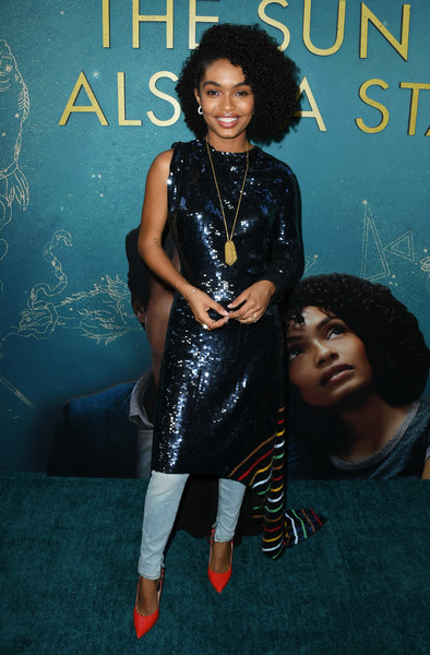 Yara Shahidi added a bright spot with a pair of red pumps by Casadei.